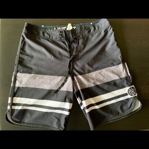 Men's size 30 Live Fit swim trunks.